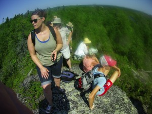 Hikers captivated by the Jack Pine/Crowberry barrens